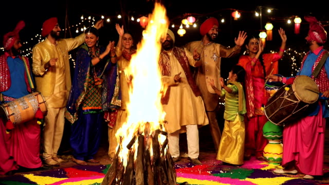 punjabi large family celebrating lohri festival, punjab, india - punjab india stock videos and b-roll footage