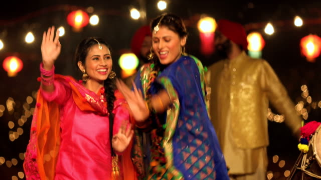 punjabi women dancing in lohri festival, punjab, india - 20 29 years stock videos & royalty-free footage