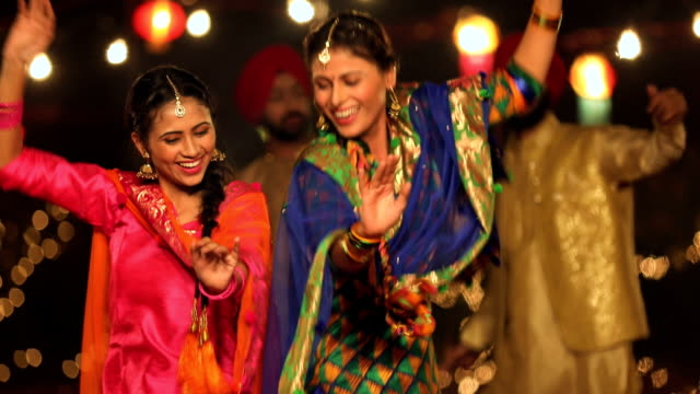 punjabi women dancing in lohri festival, punjab, india - india video stock e b–roll