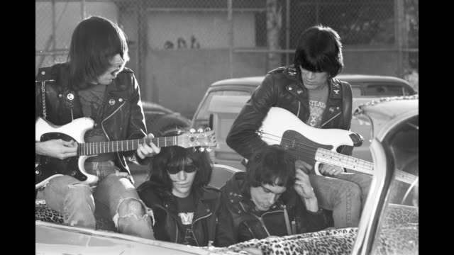 GIF GIF Punk band 'The Ramones' featuring Tommy Ramone Joey Ramone Dee Dee Ramone and Johnny Ramone ride in a convertible Cadillac driven by radio DJ...