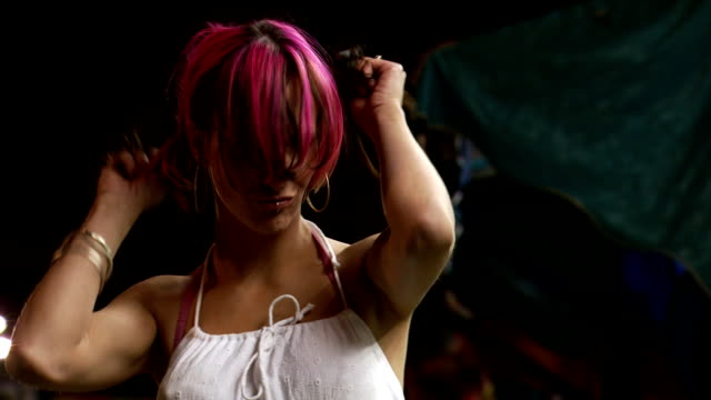 Punk female with pink hair at amusement park