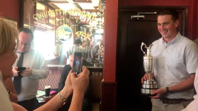 stockvideo's en b-roll-footage met punters in dublin's boar's head have their picture taken with the claret jug after shane lowry arrived with friends and supporters to celebrate... - british open