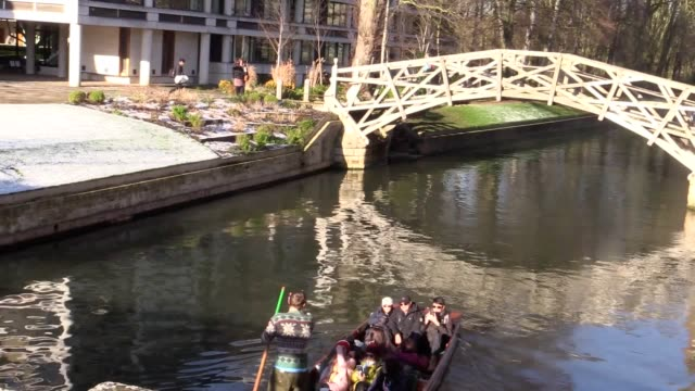 punters on the river cam in cambridge set out with tourists on board and pass king's college chapel following overnight snow - king's college cambridge stock videos and b-roll footage