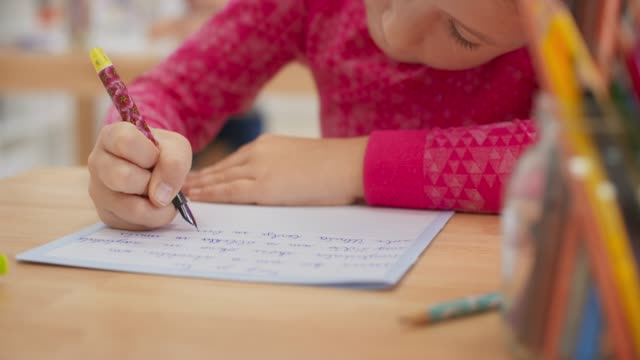 ds pupil writing into her notebook using a fountain pen - fountain pen stock videos & royalty-free footage