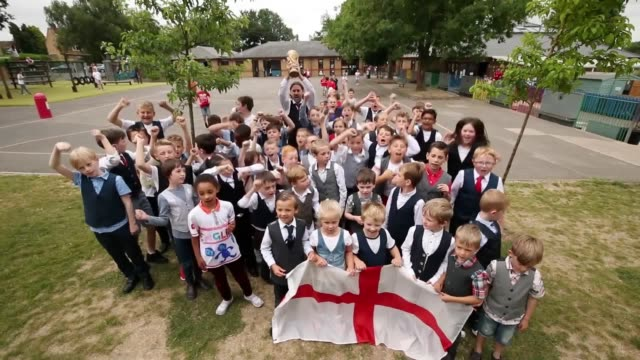 vídeos de stock, filmes e b-roll de pupils at minster church of england primary school in ramsgate wear waistcoats and england tops in honour of gareth southgate and the england team... - vest