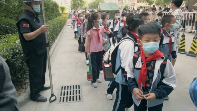 pupils go to school with masks - school building stock videos & royalty-free footage