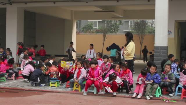 ms pan pupils in school/xian,shaanxi,china - school children stock videos & royalty-free footage