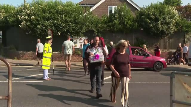 pupils wave goodbye to lollipop lady after 34 years; england: east sussex: brighton: woodingdean primary school: ext various of lollipop lady theresa... - differential focus stock videos & royalty-free footage