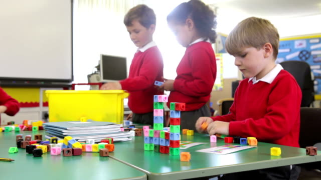 Pupils Working With Coloured Blocks