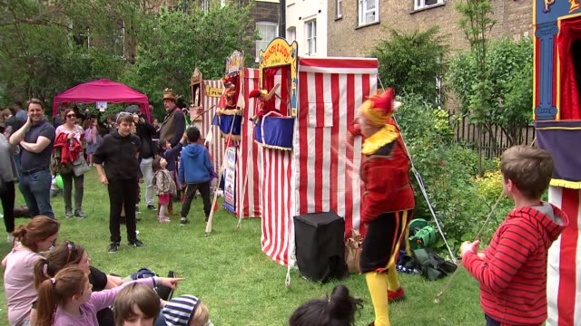 puppet festival celebrates 357th anniversary of mr punch england london covent garden ext punch and judy stands set up as people sing happy birthday... - birthday stock videos & royalty-free footage