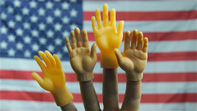 puppet hands rising on usa flag background - puppet stock videos & royalty-free footage