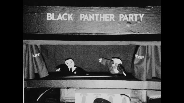 puppet show performed for neighborhood children by new haven panthers in their chapter house concerning the government efforts to suppress the party... - アメリカ黒人の歴史点の映像素材/bロール