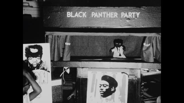 puppet show performed for neighborhood children by new haven panthers in their chapter house concerning the government efforts to suppress the party... - black panther stock videos & royalty-free footage
