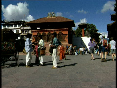 puppets hanging in kathmandu square - marionette stock-videos und b-roll-filmmaterial