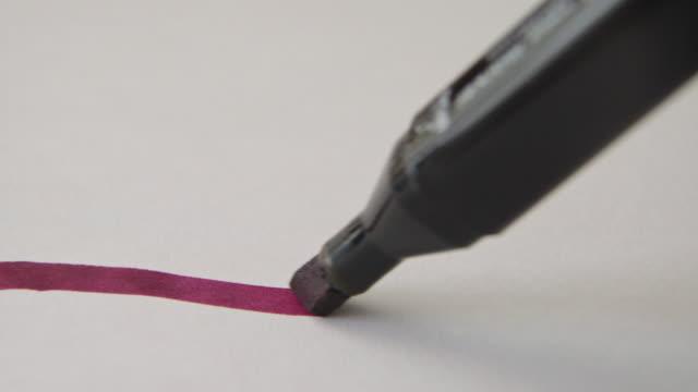 puprple color pen - stift stock-videos und b-roll-filmmaterial