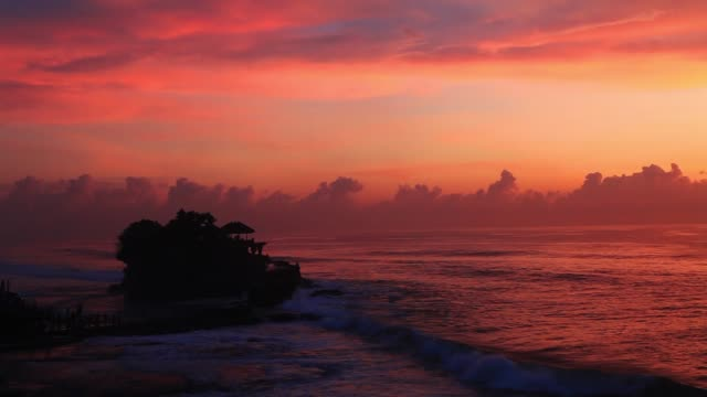 Pura Tanah Lot Temple at sunset. Bali
