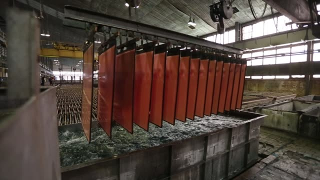 Pure copper cathode sheets are removed from electrolytic tanks in the electrolytic refining plant also known as the tankhouse at the copper mining...