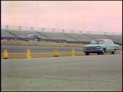 """pure oil flag flying / starting line; nascar official waves checkered flag for 1966 amc classic / classic passes under the """"acceleration test"""" banner... - 1966 stock videos & royalty-free footage"""