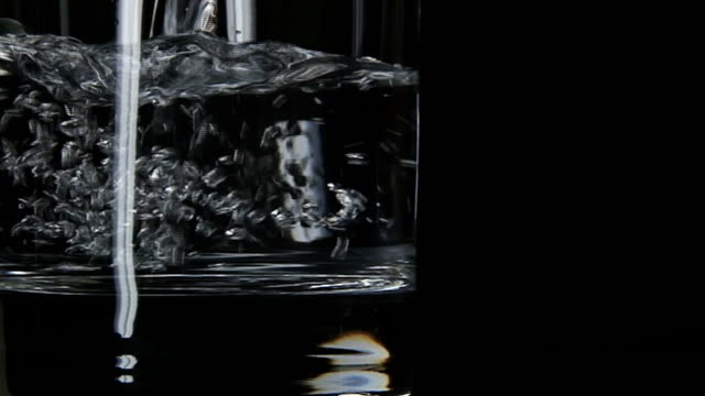 pure, still water pouring in glass - double refraction stock videos & royalty-free footage