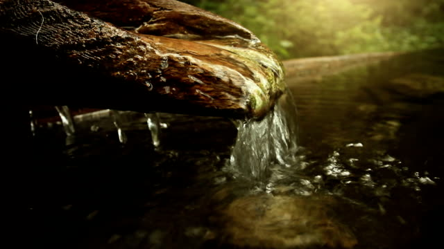 pure water springs from a wooden fountain - spring flowing water stock videos and b-roll footage