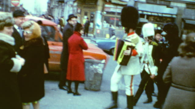 vidéos et rushes de purim in williamsburg / children walking to the parade / street scenes / people dressed in costume / young men talking to each other / celebrating... - instrument de musique