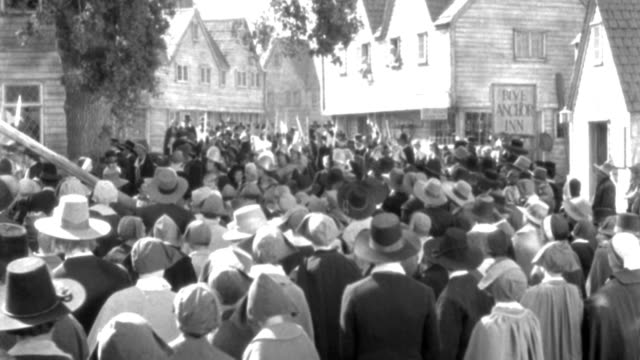 puritan townspeople watch as soldiers march past in salem, massachusetts. - salem stock videos & royalty-free footage