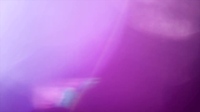 purple abstract background with bokeh - 4k - lens flare stock videos & royalty-free footage