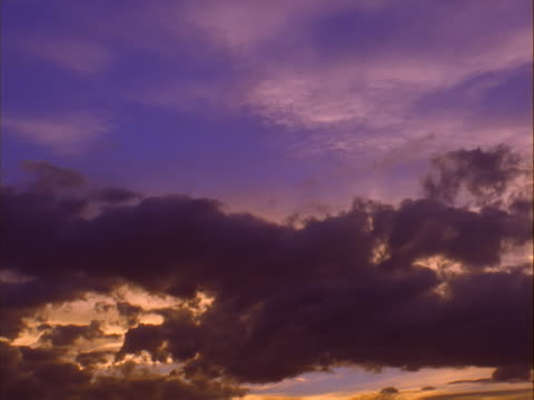 Purple and yellow clouds at sunset