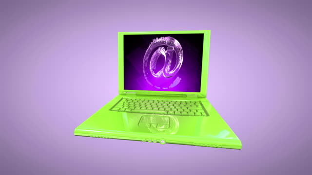 a purple at symbol appears on the lcd screen of a green laptop. - 'at' symbol stock videos and b-roll footage