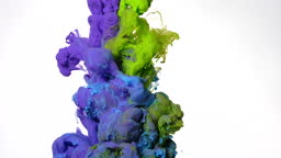 Purple, blue and green watercolor ink mixed in water on a white background. Slow motion of colored acrylic paints in water.