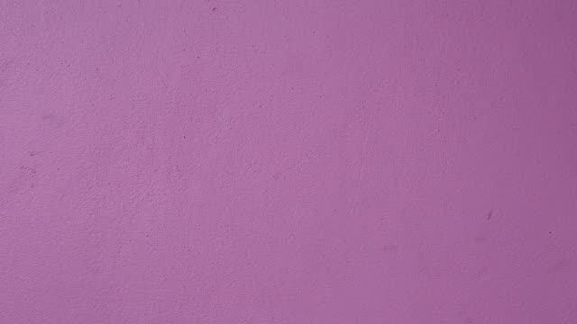 Purple cement walls for background design.