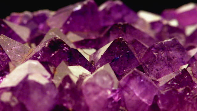 ecu, selective focus, purple crystal - quarzo video stock e b–roll
