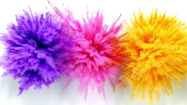 purple, pink and orange colored powder exploding towards camera at the same time in close up and super slow-motion, white background - tre oggetti video stock e b–roll