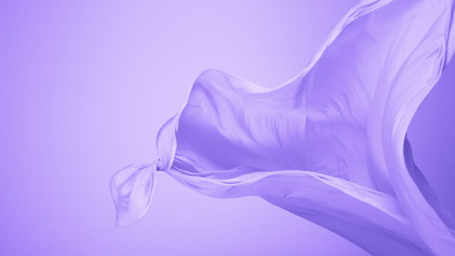 purple silky fabric flowing by wind in purple background, slow motion - textile stock-videos und b-roll-filmmaterial