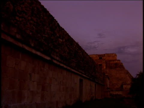 a purple sky glows above mayan ruins. - mayan stock videos & royalty-free footage