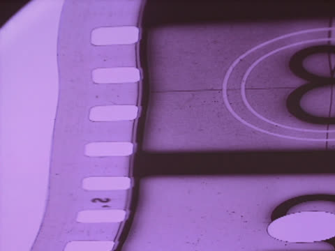 purple tone countdown film strip falling off of screen - mpeg videoformat stock-videos und b-roll-filmmaterial