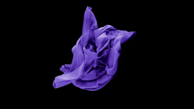 vídeos de stock e filmes b-roll de purple transparent fabric flowing by wind in black background, slow motion - purple