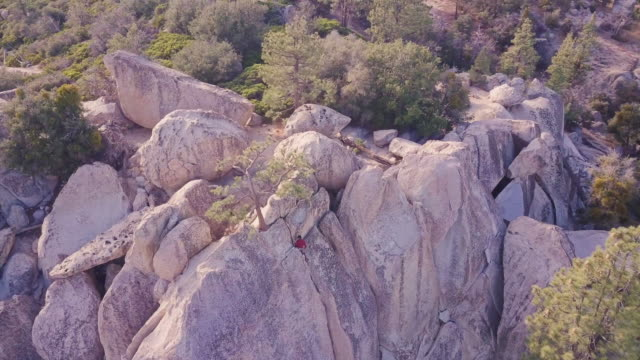 push in drone shot of climber attaching anchor on cliffside in stunning california landscape - angeles national forest stock videos and b-roll footage