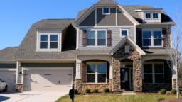 Push in establishing shot of a modern generic suburban middle class home