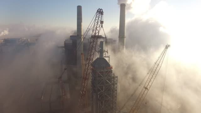 Push in fog at power plant, Drone 4K Industry Aerial Video, Power plant coal, natural gas, wind farm, renewable energy, smokestack,