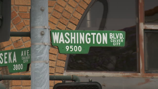 push in of the washington blvd street sign in culver city los angeles, hollywood studios - culver city stock videos & royalty-free footage