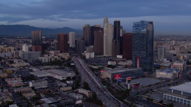 push in over the harbor freeway towards the skyscrapers of downtown los angeles. - push in stock videos & royalty-free footage
