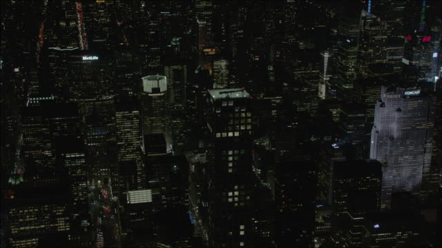 Push in shot of the 432 Park Avenue at night