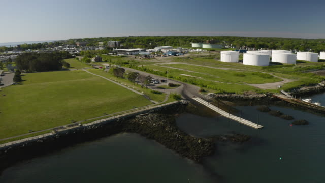 push in shot of the bug light park with oil tanks in the background - north atlantic ocean stock videos & royalty-free footage