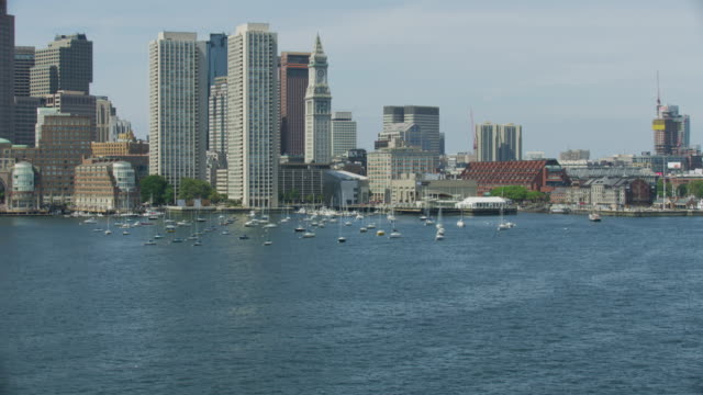 push in shot of the custom house tower from above the boston harbor - custom house tower stock videos & royalty-free footage