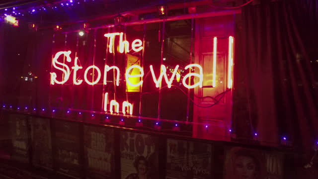 push in shot of the neon name sign of stonewall inn - 1969 stock videos & royalty-free footage