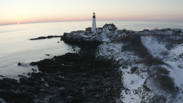 push in shot of the portland head light at sunset - north atlantic ocean stock videos & royalty-free footage