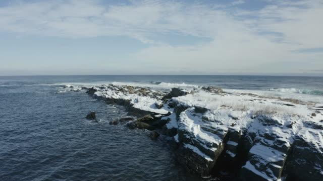 push in shot shot of ocean waves crashing on the rocky coastline in casco bay - north atlantic ocean stock videos & royalty-free footage