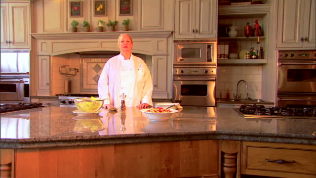 push in to a portrait of a chef looking at the viewer as she crosses her arms. - push in stock videos & royalty-free footage
