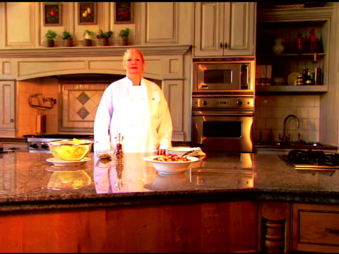 push in to a portrait of a chef looking at the viewer as she puts her hands on her hips. - push in stock videos & royalty-free footage